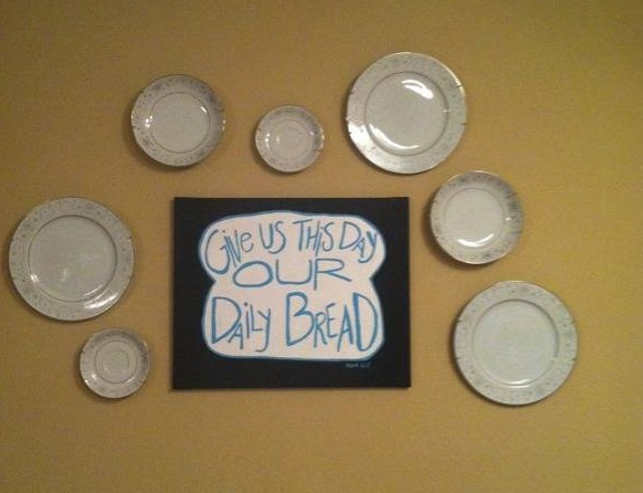 Kitchen wall hanging with painted canvas and plates