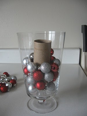 place ornaments in a glass container for low cost christmas decor